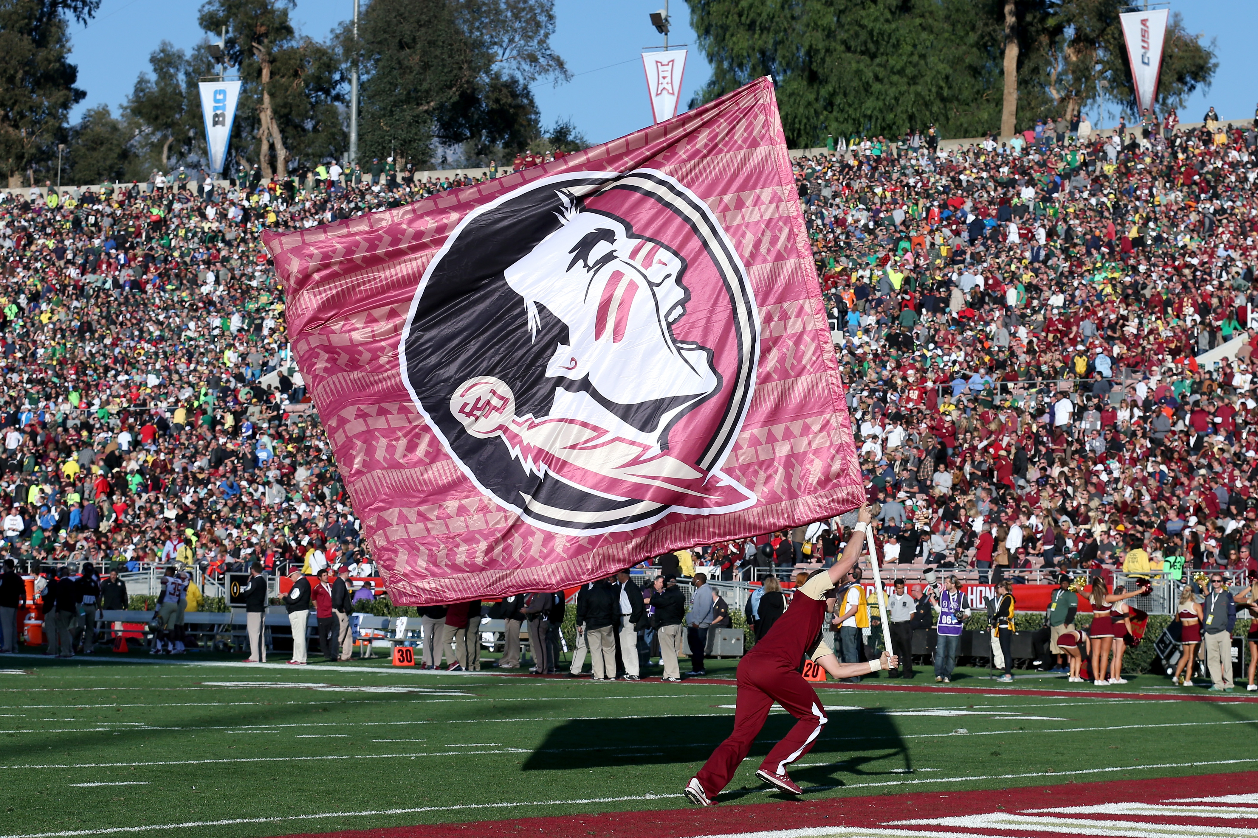 Fsu football which 2019 florida recruits can seminoles land pasadena ca january 01 a florida state seminoles cheerleader runs with a flag on the field during the college football playoff semifinal against the voltagebd Choice Image