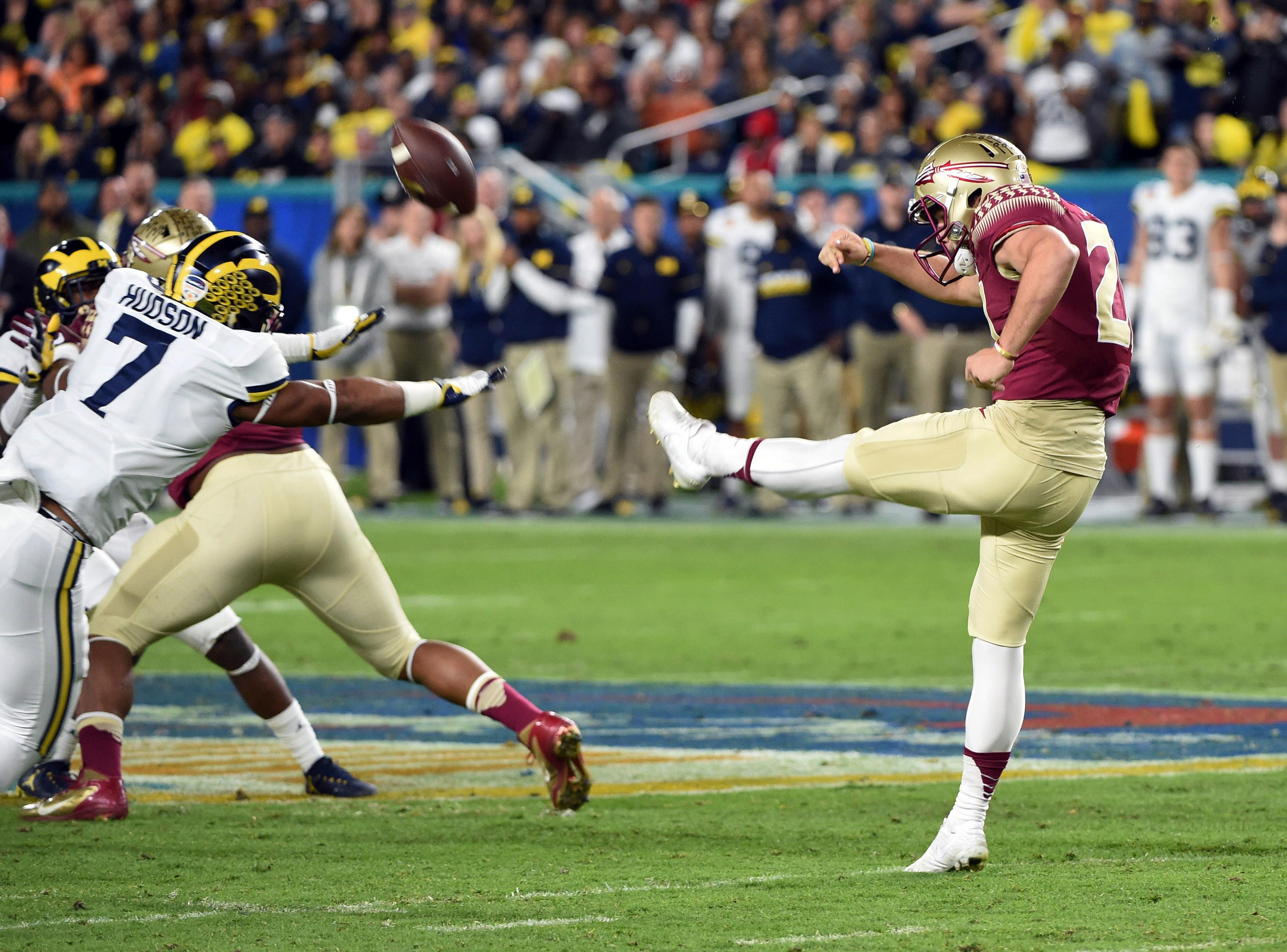 Dec 30 2016 Miami Gardens Fl Usa Michigan Wolverines Safety Khaleke Hudson 7 Attempts To Block A Punt From Florida State Seminoles Place Kicker Logan